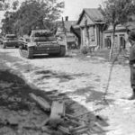 Column of Panzer III Ausf J tanks on a road in Russia