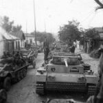 Column of Panzer III tanks on a road in Russia
