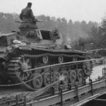 Panzer III crossing a pontoon bridge