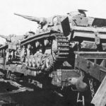 Panzer III tanks being transported on rail cars