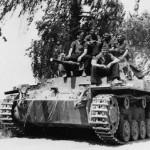 Crew atop a Panzer III 5