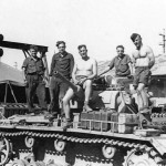 Crew work on a Panzer III tank in a workshop