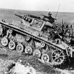 German infantry ride on a Panzer III