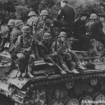 German roops riding on the back of the Panzer III