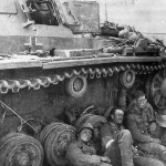German soldiers resting next to a Panzer III