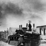 German tank officer atop Panzer III on outskirts of Wjasma 1941