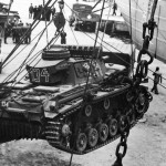Panzer III 134 DAK tank being loaded into a ship