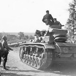 Panzer III passing wehrmacht troops