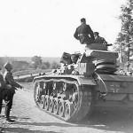 Panzer III passing wehrmacht troops