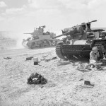 Stuart tank passes by a destroyed German Panzer III November 1942