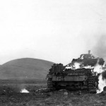 US soldier approaches burning Panzer III at Madjez El Bab 12 January 1943