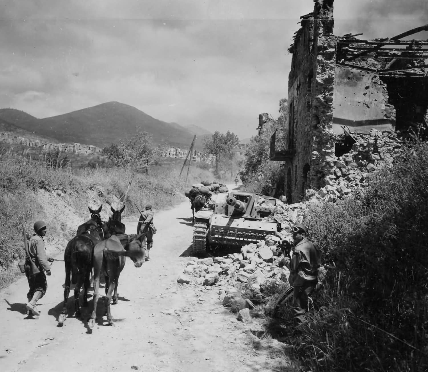 5th Army Troops and Mules Pass German StuG 40 Assault Gun Castelforte Italy 1944