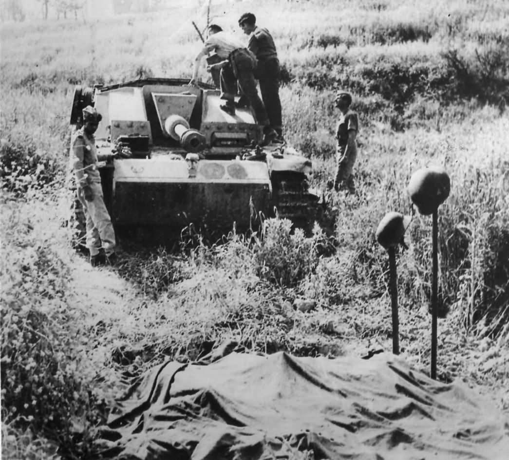 Canadian Troops Bury Crew of Blasted German StuG III in Italy 1944