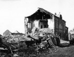 Soldier by Wreckage of German StuG 40 ausf G in Noville 1944