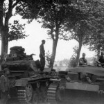 Panzer III is passed by a StuG III