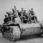 German troops sit on StuG III