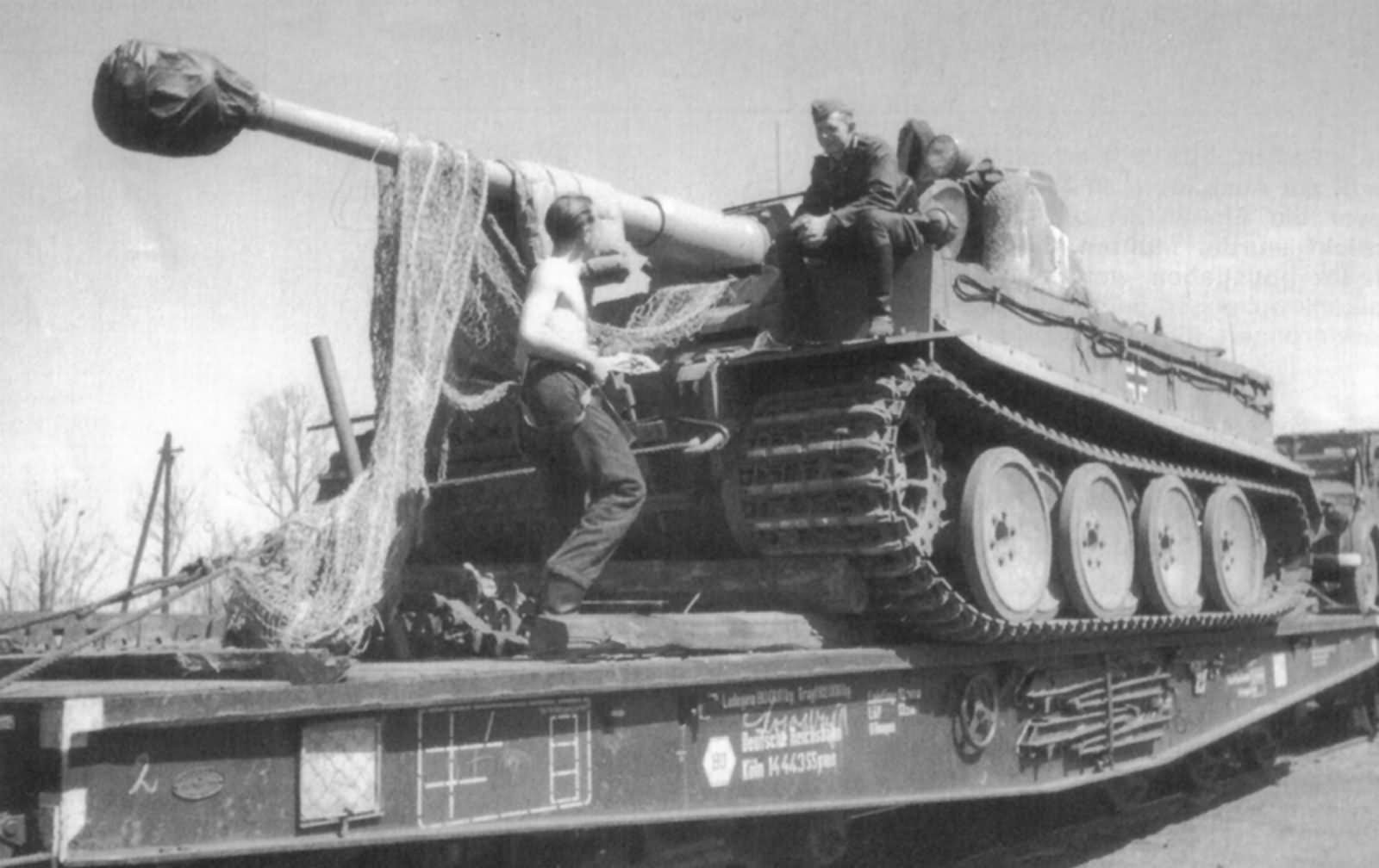 Tiger of the Schwere Panzer Abteilung 503, tank code II. Tank being transported on rail car.