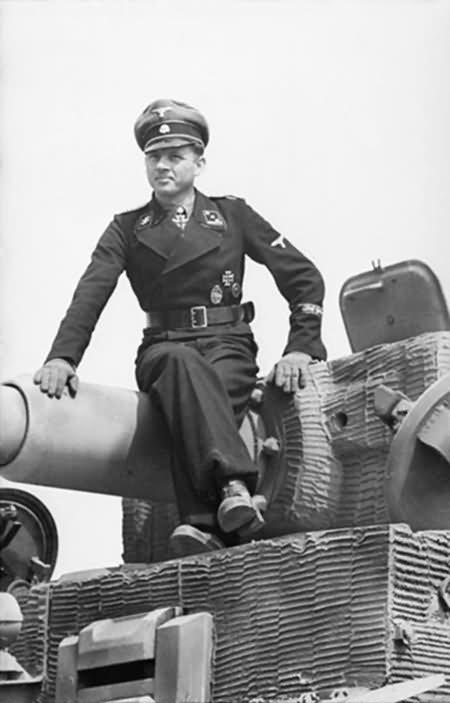 Michael Wittmann sitting on a Panzer VI Tiger