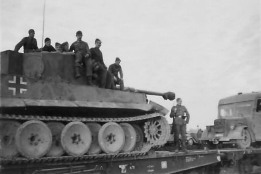 Panzer VI Tiger tank of the schwere Panzer Abteilung 502. Tank being transported on rail car.