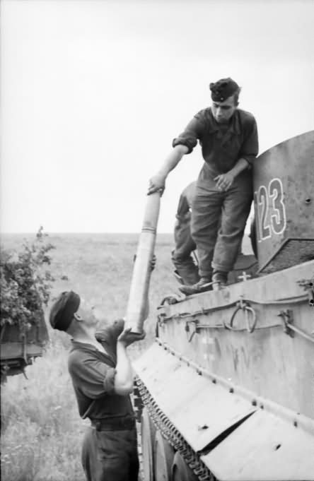 Crew loading ammo into Tiger I tank number 123 of Schwere Panzer Abteilung 503