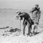 Afrika korps soldiers filling sandbags in desert