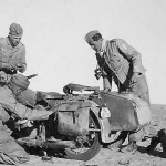 Luftwaffe afrika korps soldiers working on motorcycle