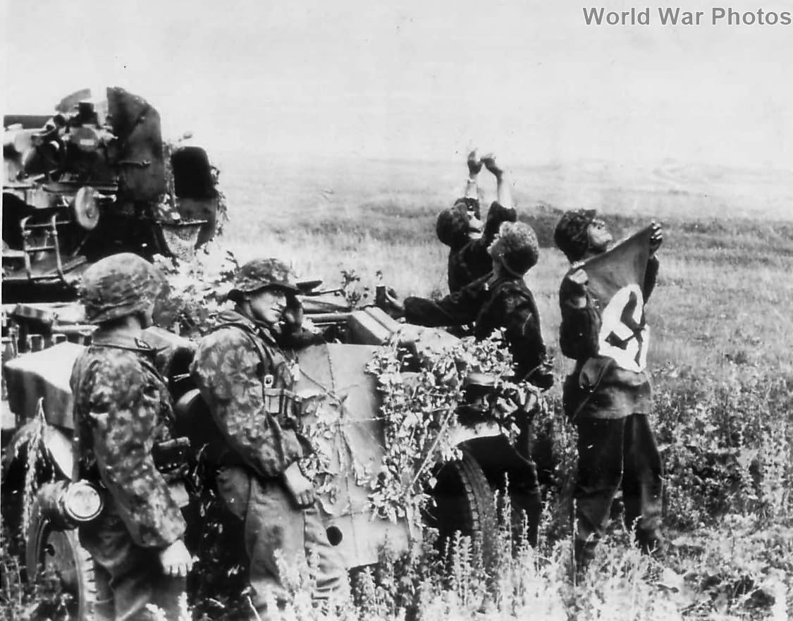 Flak-Kanoniere of the 2 SS-Panzer-Division Das Reich wave a