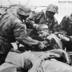 Kradschutze of 3rd SS Totenkopf aid wounded comrade