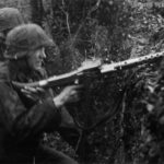 Waffen SS trops with MG 34 attacking village on Eastern Front