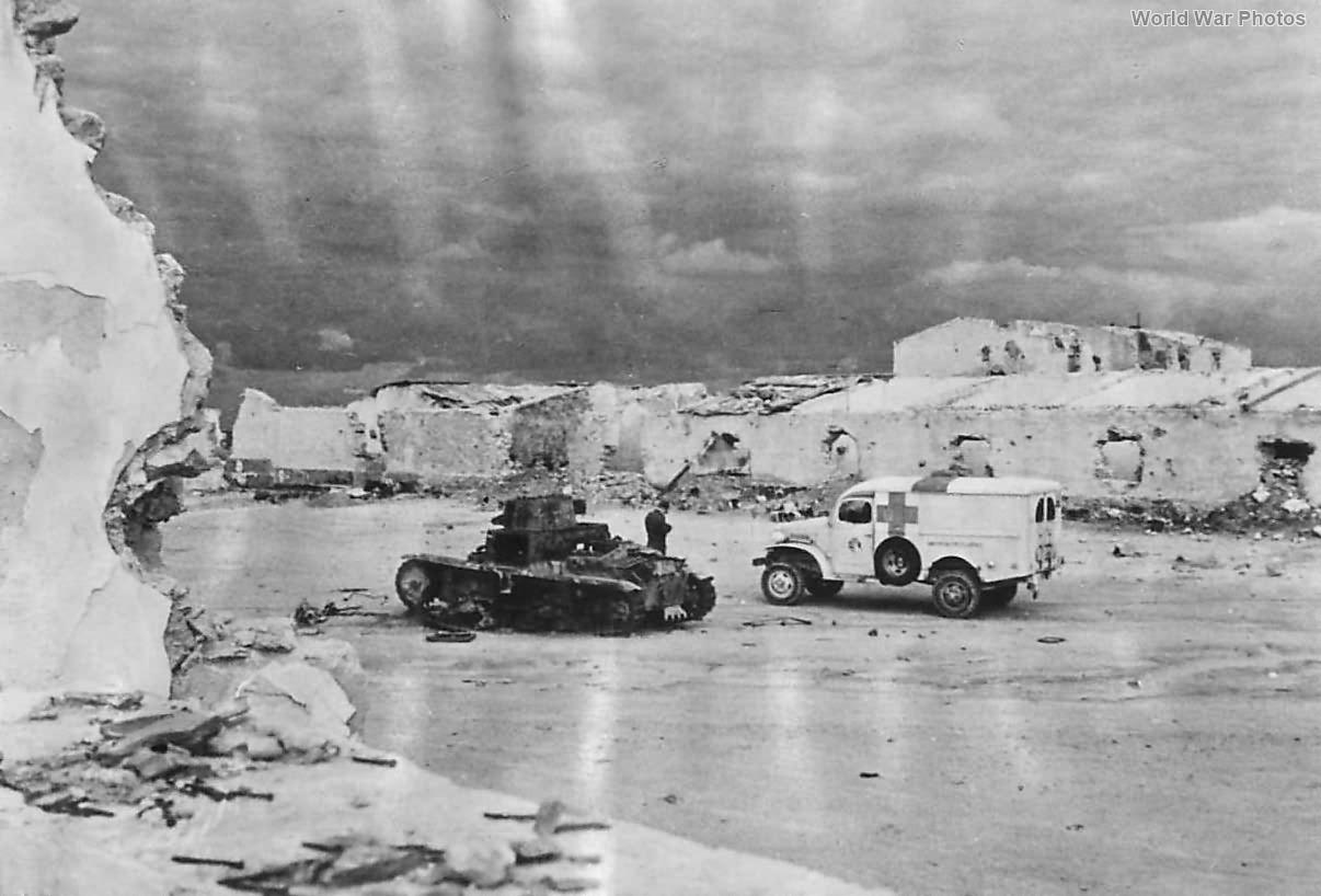 US Ambulance Drivers Inspect KO M13/40 Tunisia 1943