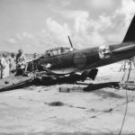 US troops inspect the wreckage of A6M5 Zero code 8-13 on Saipan