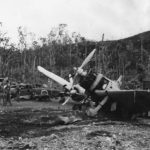 US troops inspect wrecked A6M Zeros and D3A Val at Munda Airport