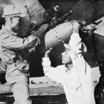 Loading a 60 kg bomb on a B5N