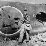 Mitsubishi G4M wreck and Marine photographer