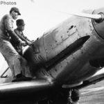 Mechanics using a hand crank to start the engine of Ki-60