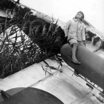 Japanese Boy atop wreck of Kawasaki Ki-61 Hien Tony in Japan 1945