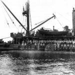 Crew of the submarine rescue vessel USS Ortolan ASR-5 standing on the hull of Japanese midget submarine Ha-8 which they raised just off the coast of Guadalcanal 1943