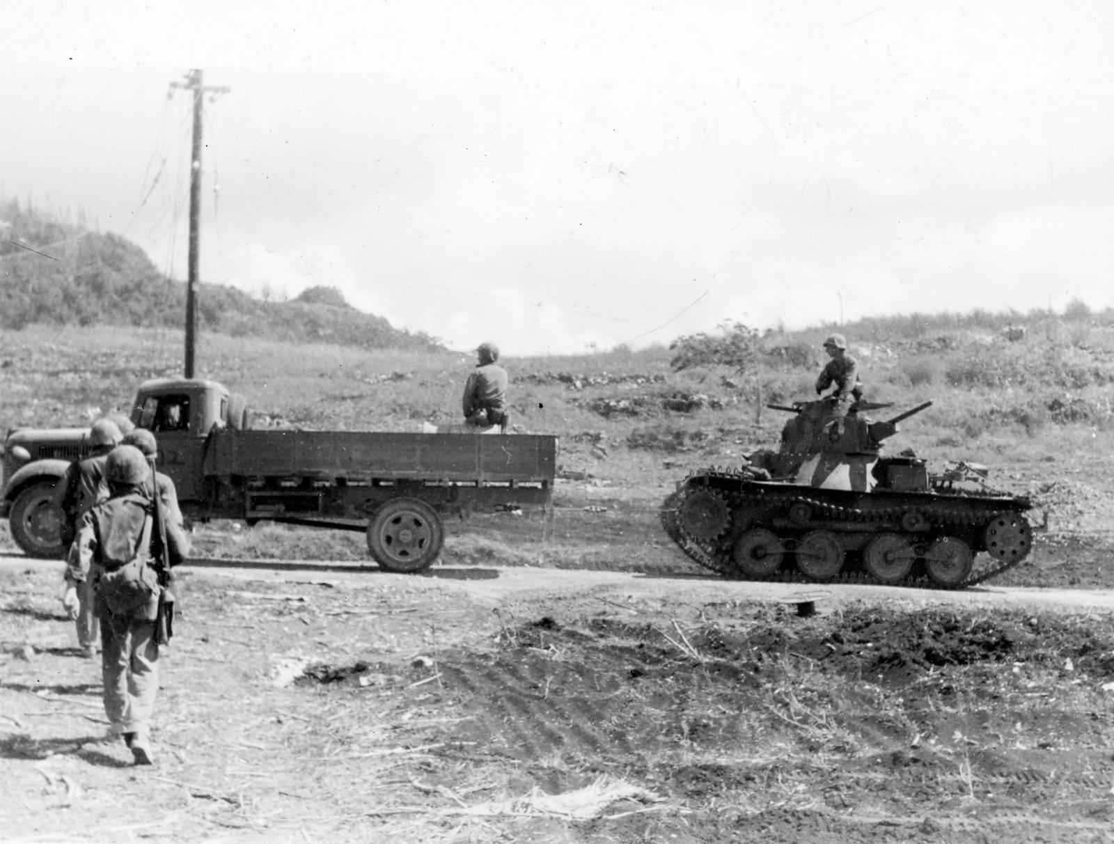 Marines Use Captured Japanese Truck to Tow Type 95 Ha Go Light Tank Saipan 1944