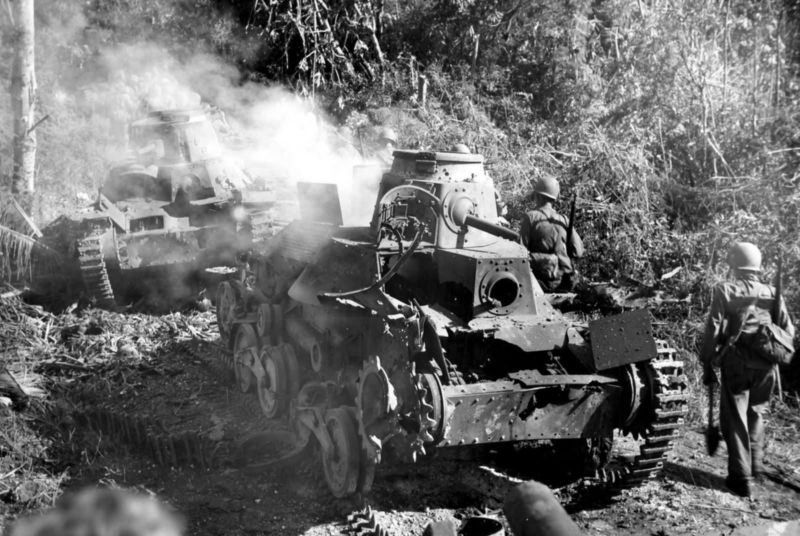 Type 95 Ha Go light tanks burning on Guam 1944
