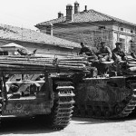 Flame throwing tanks Churchill Crocodiles wait in Granarolo dell'Emilia Italy April 1945