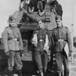A group of German soldiers inspect a British cruiser tank A13 Mk II 2