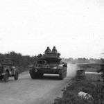 Crusader tank moving on country road England