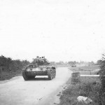 Crusader tank moving on country road England photo