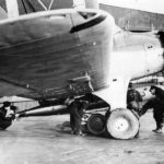FAA pilot supervises loading of torpedo on his Albacore