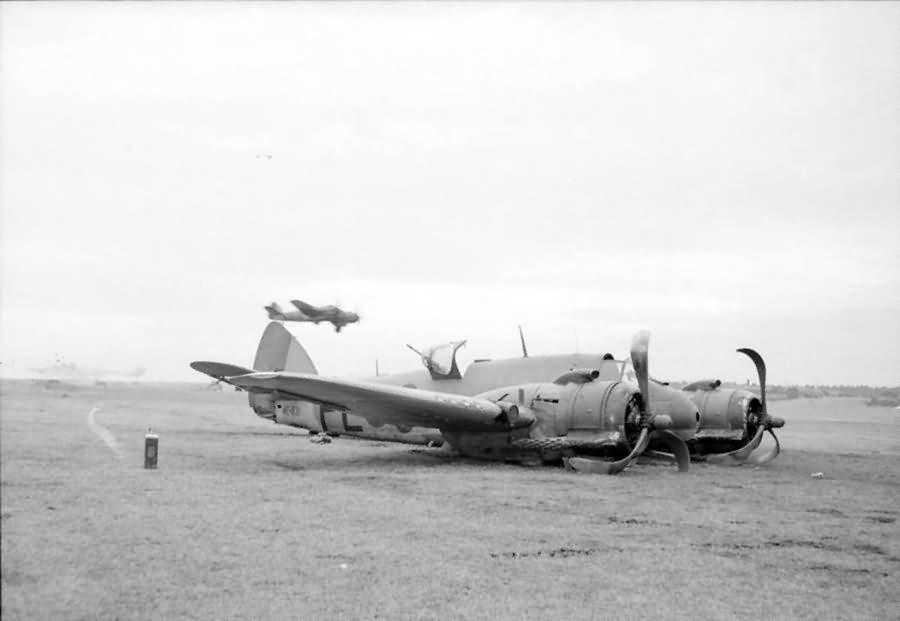 Damaged Beaufighter TF Mk X NE831 code PL-O of No 144 Squadron RAF at Dallachy