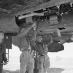 Armourers of No 89 Squadron RAF servicing the 20mm Hispano cannons of a Bristol Beaufighter Mk VIF at Castel Benito Libya