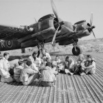 Beaufighter Mk X and crews of No 16 Squadron SAAF and No 227 Squadron RAF sitting in a dispersal at Biferno Italy