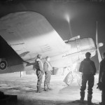 Bristol Beaufighter Mk VIF MM849 code VA-I of No. 125 Squadron RAF being prepared for a night sortie at Exeter