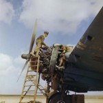 Ground crew overhauling a Bristol Beaufighters Hercules engines (color photo)