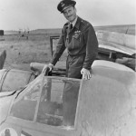 Wg Cdr A. K. Gatward commander of No 404 Squadron RCAF standing in the cockpit of his Beaufighter TF Mk X at Davidstow Moor